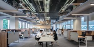 People working in a large modern office